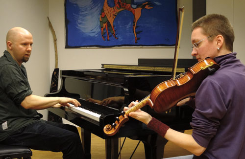 Juha and lydia play piano and fiddle at the Sibelius Academy in Helsinki