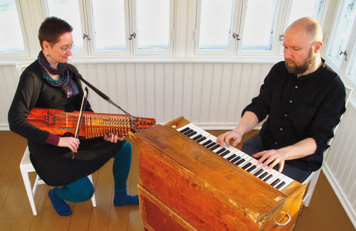 lydia and Juha play nyckelharpa and harmonium during recording in Finland